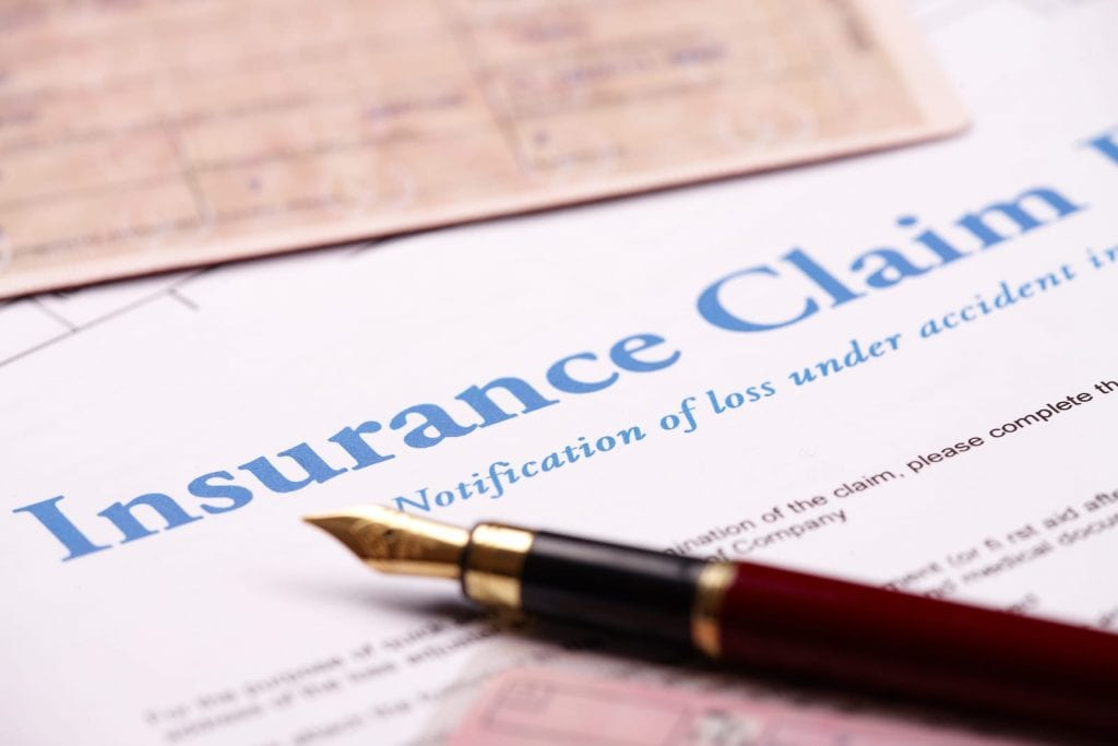 what do insurance adjusters do